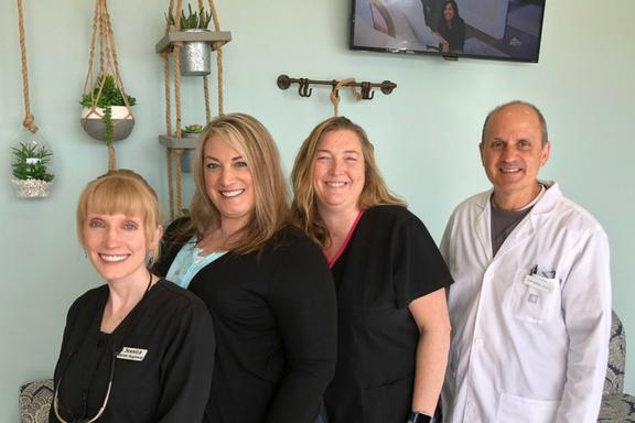 team photo of college ave modern dental team